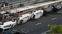1.6M USD in damages after truck carrying high-end vehicles overturns in China
