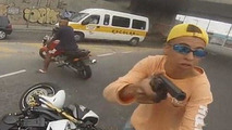 Biker jacked at gunpoint before thief shot by cop - caught on helmet cam