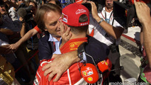 Michael Schumacher celebrates pole position with Luca di Montezemolo
