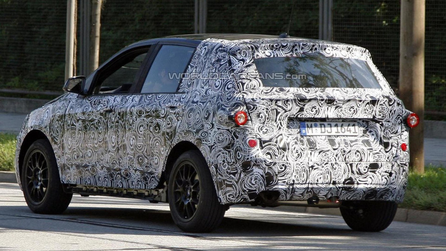 2013 BMW FWD prototype spied with less camouflage