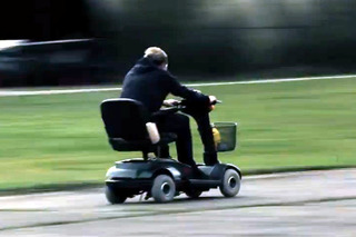 Man Who Built World's Fastest Mobility Scooter Holds Four Other Records [w/video]