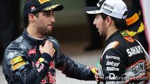 (L to R): Daniel Ricciardo, Red Bull Racing with Sergio Perez, Sahara Force India F1 at the podium