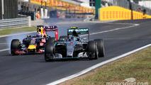 Nico Rosberg, Mercedes AMG F1 Team and Daniel Ricciardo, Red Bull Racing