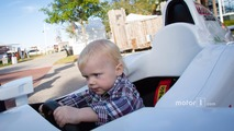 Dan Wheldon Memorial and Victory Circle unveiling ceremony- Oliver Wheldon has fun in an IndyCar