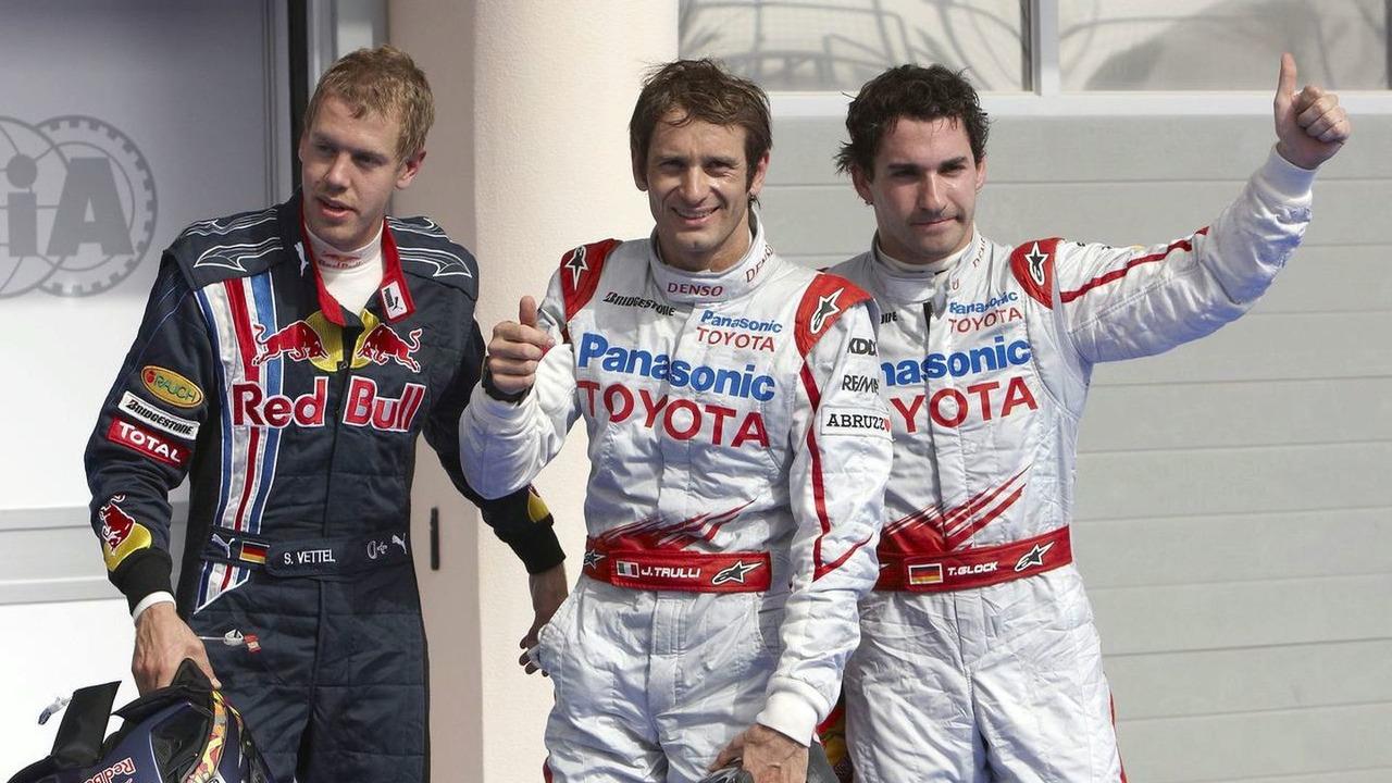 Sebastian Vettel, Jarno Trulli and Timo Glock celebrate after qualifying in Bahrain 2009.