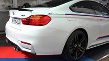 BMW M4 with M Performance parts at Abu Dhabi Motors dealership