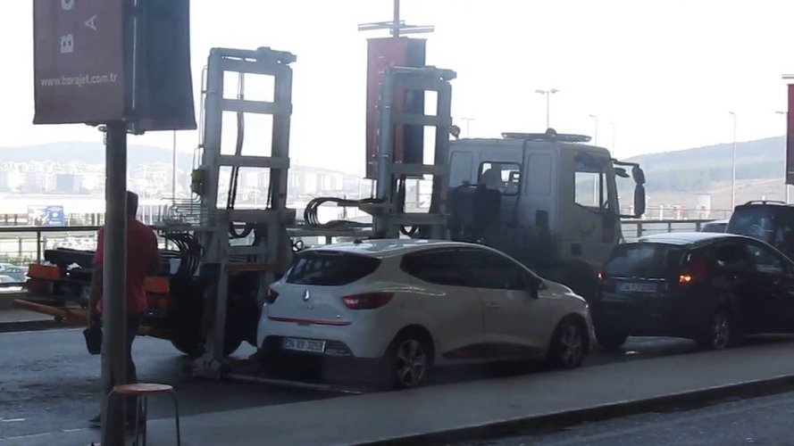 Watch a tow truck take a car away in 60 seconds flat