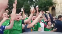 Irish soccer hooligans repair car damaged during march