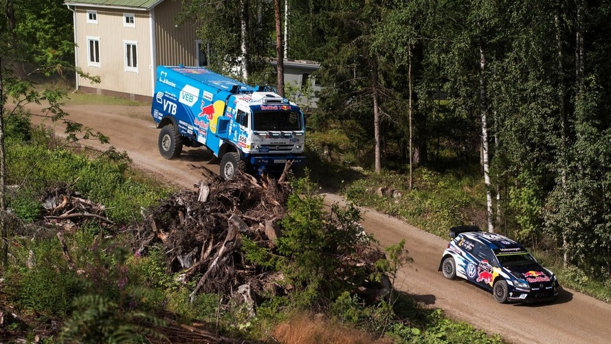 Watch a Kamaz Dakar truck catch air chasing down VW WRC car