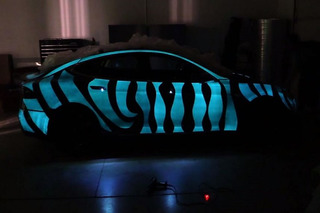 Glow In The Dark Tesla Looks Like 'Tron' Light Cycle [Video]