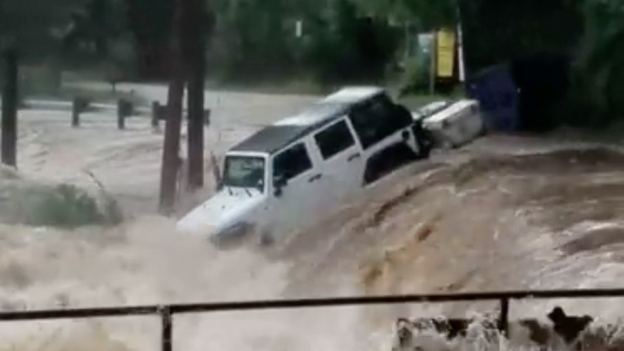 Owner can only watch as his Jeep washes away