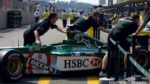 A Jaguar being pushed back in the garage