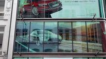 Audi welcomes Tesla in Hamburg through a billboard