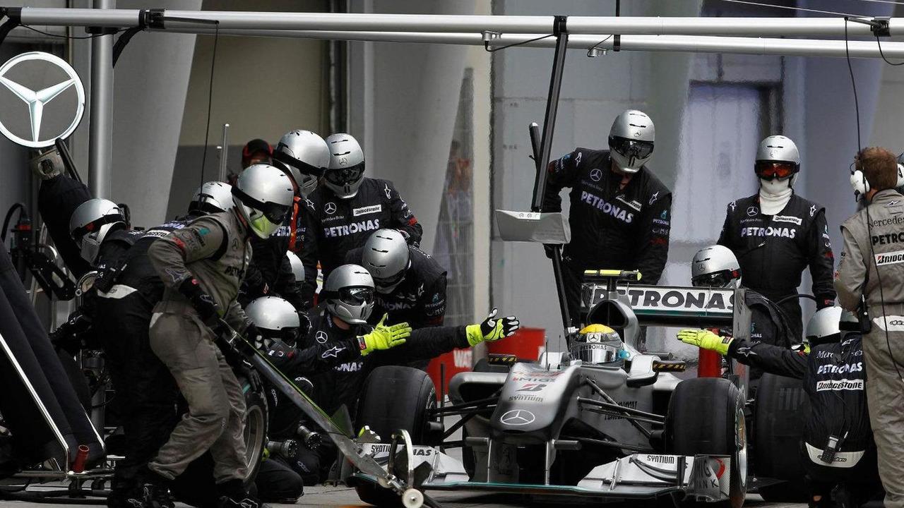 Michael Schumacher (GER) pit stop, Mercedes GP Petronas, Malaysian Grand Prix, 04.04.2010 Kuala Lumpur, Malaysia