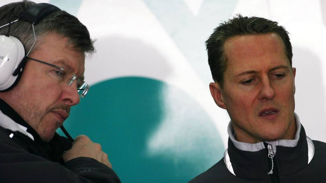 Ross Brawn (GBR) Team Principal, Michael Schumacher (GER), Mercedes GP, 03.02.2010 Valencia, Spain