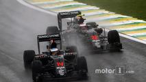 Fernando Alonso, McLaren MP4-31 leads team mate Jenson Button, McLaren MP4-31