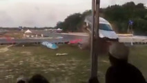 Race car goes airborne and smashes into crowd, injuring four