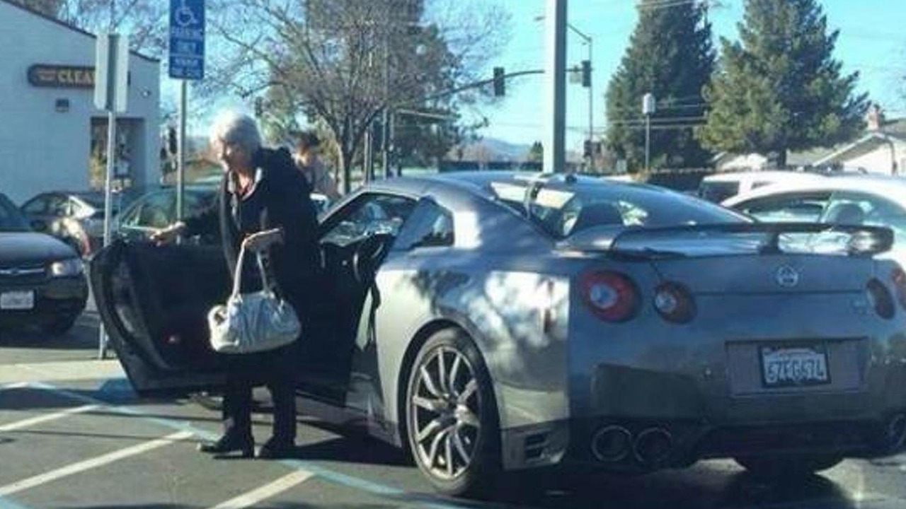 Granny exiting a Nissan GT-R at a supermarket parking