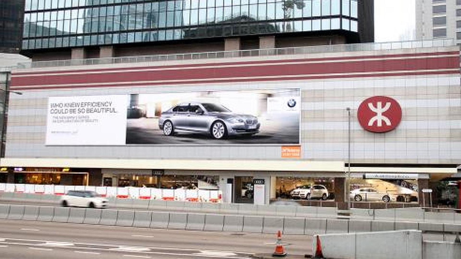 BMW plasters massive billboard above Audi Hong Kong
