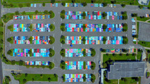 High school students personalize reserved parking spots with paint