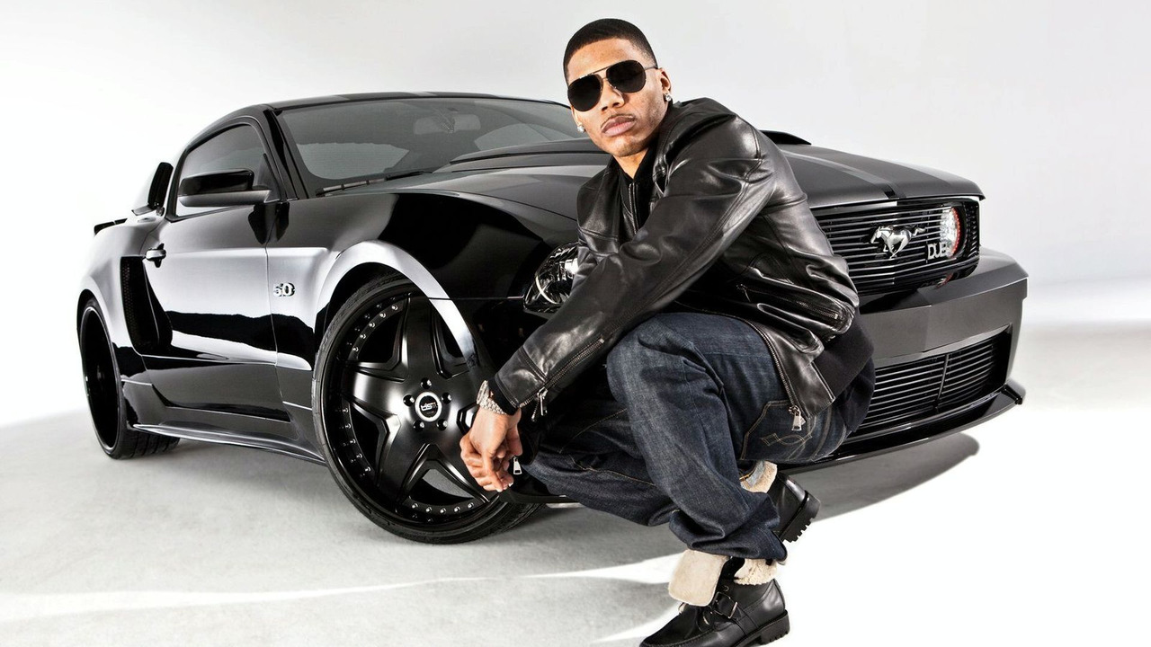 Nelly poses with 2011 DUB Edition Mustang 5.0