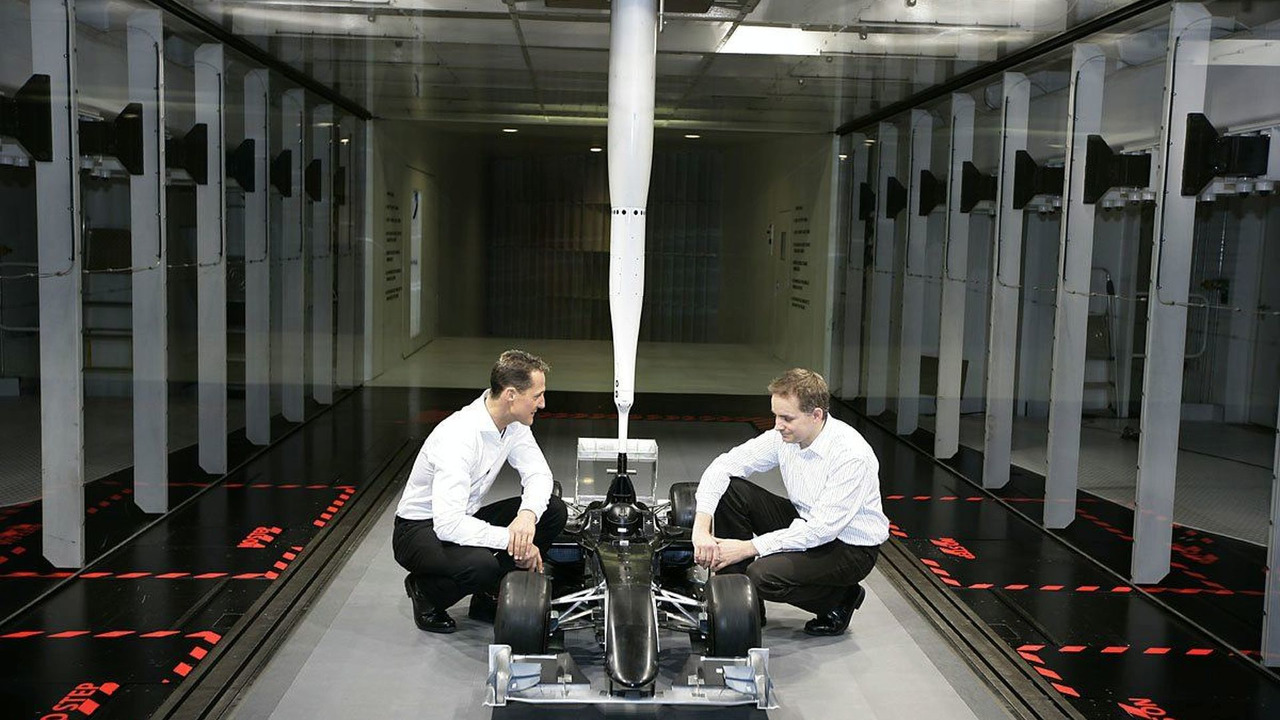 Michael Schumacher and John Owen in Wind Tunnel, Mercedes GP, Brackley, 23.12.2009