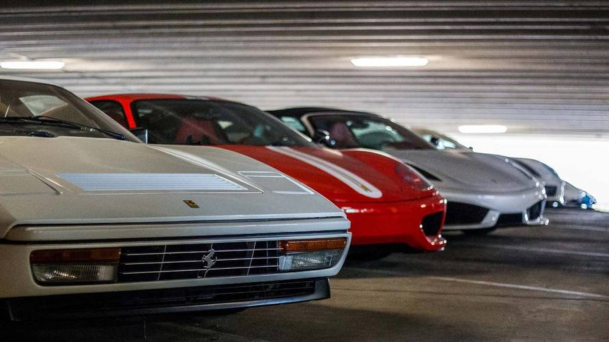 This amazing car collection is stored in a open parking garage for 7 car garage