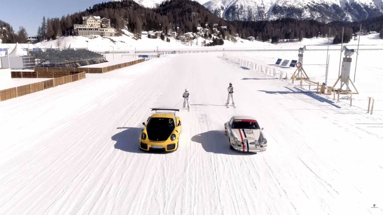 Porsche pulling skiers on frozen lake