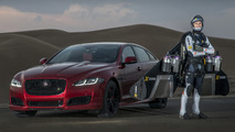 Jaguar XJR races a human jet [video]