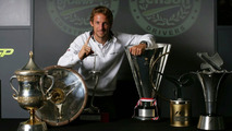 Jenson Button with his race-winning trophies