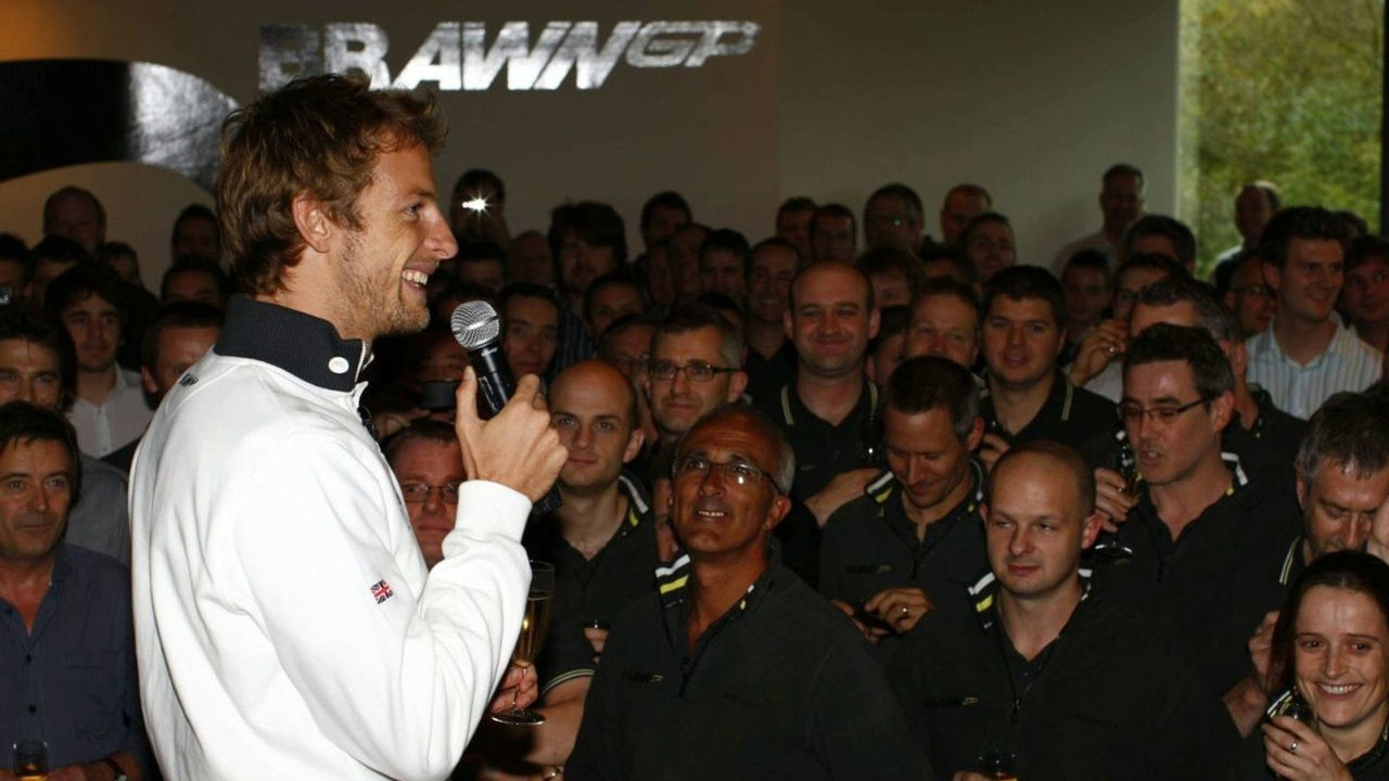 Jenson Button celebrates with Brawn GP staff, Brawn GP, Brackley, UK, 21.10.2009