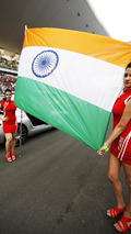 Indian flag with grid girls 28.10.2012 Indian Grand Prix