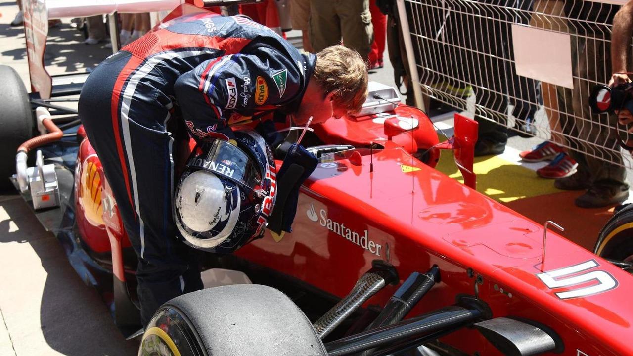Sebastian Vettel looking inside Ferrari 25.06.2011 European Grand Prix