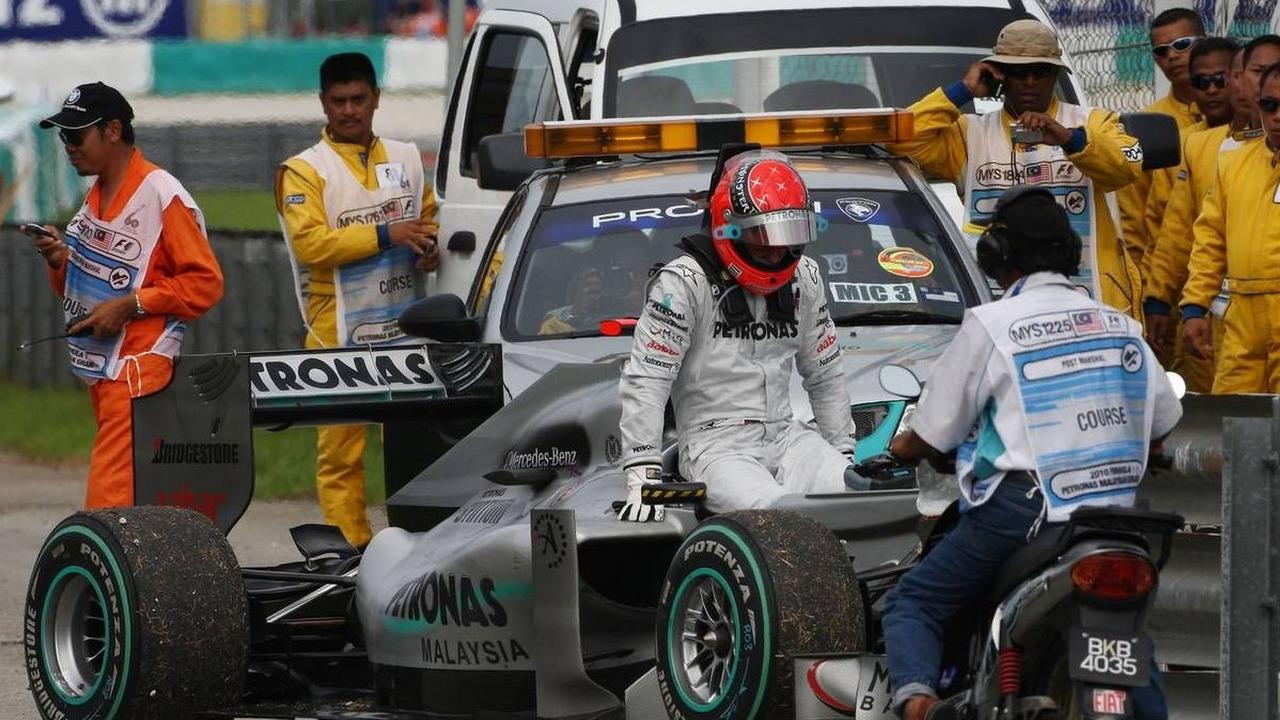 Michael Schumacher (GER), Mercedes GP Petronas, stops on the circuit, Malaysian Grand Prix, Sunday Race, 04.04.2010 Kuala Lumpur, Malaysia