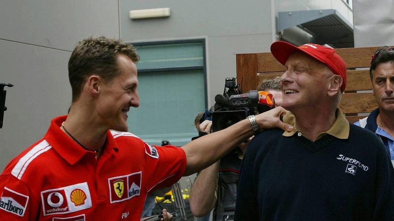 Michael Schumacher, GER, Ferrari talks with Niki Lauda, AUT, Australian Grand Prix, 05.03.2004 Melbourne, Australia, Friday