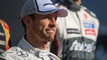 Button resorts to jokes as McLaren wait continues