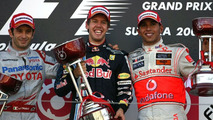 Jarno Trulli (ITA) 2nd, Toyota F1 Team , Sebastian Vettel (GER) 1st, Red Bull Racing and Lewis Hamilton (GBR) 3rd, McLaren Mercedes - Formula 1 World Championship, Japanese Grand Prix, Sunday Podium, Suzuka, Japan, 04.10.2009