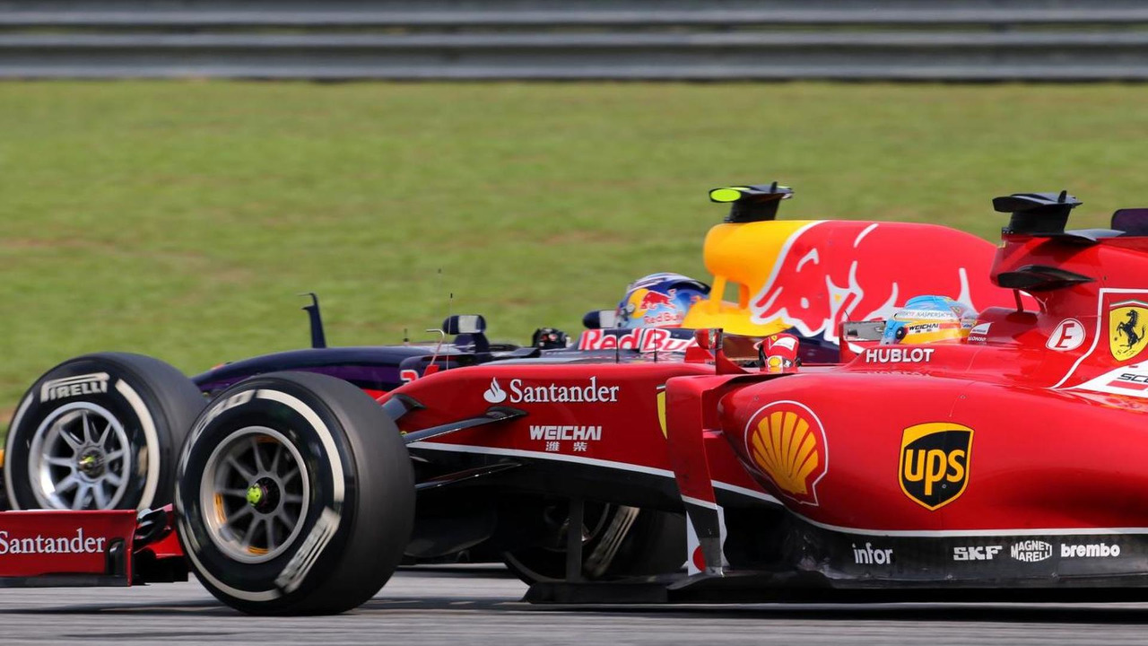 Fernando Alonso (ESP) and Sebastian Vettel (GER), 30.03.2014, Malaysian Grand Prix, Sepang / XPB