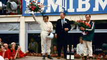 From left- Bruce McLaren, Henry Ford II and Chris Amon on the victory podium after the 1966 24 Hours of Le Mans