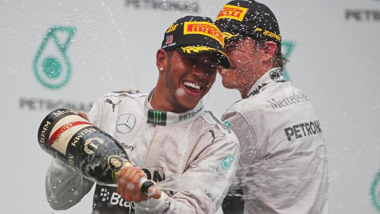 Race winner Lewis Hamilton (GBR) celebrates on the podium with second placed team mate Nico Rosberg (GER), 30.03.2014, Malaysian Grand Prix, Sepang / XPB