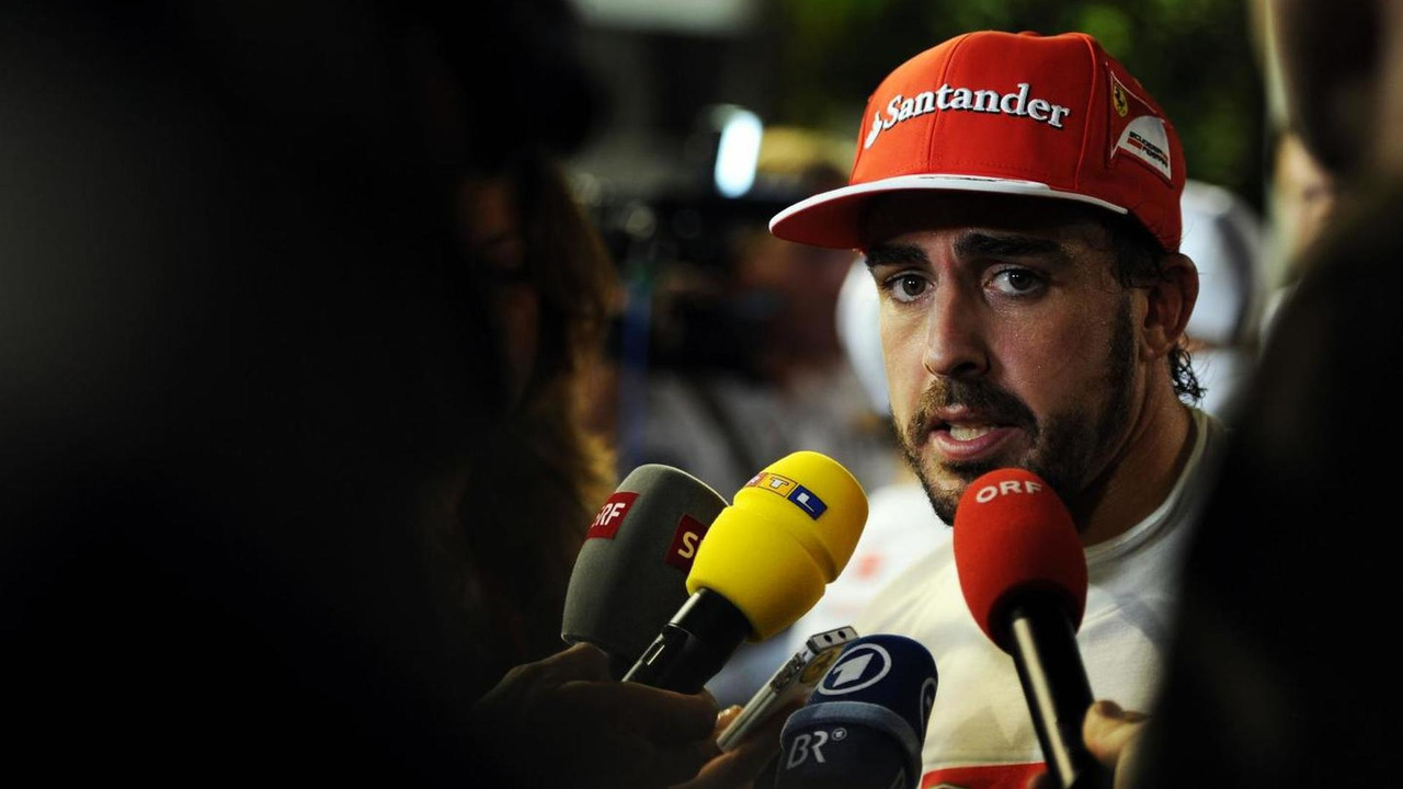 Fernando Alonso (ESP) with the media, 20.09.2014, Singapore Grand Prix, Singapore / XPB