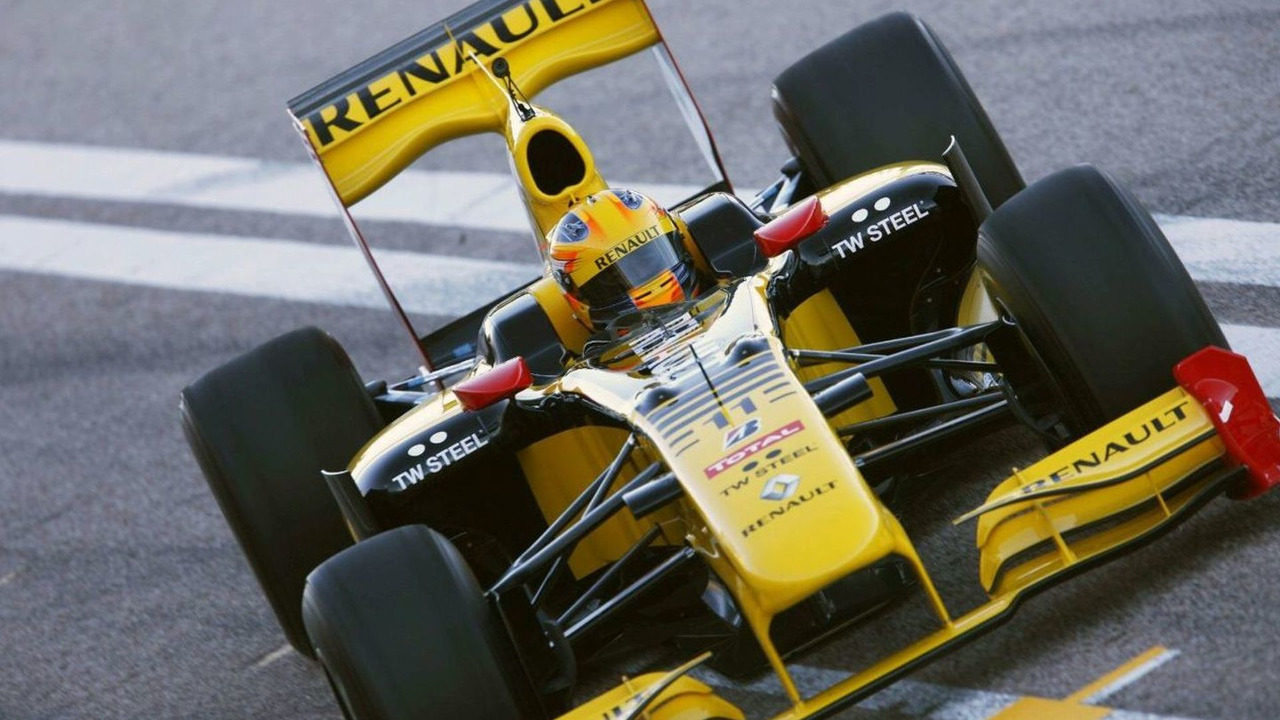 Robert Kubica, Renault R30, drives down the pit lane, after his first run in the new car, Valencia, Spain, 01.02.2010