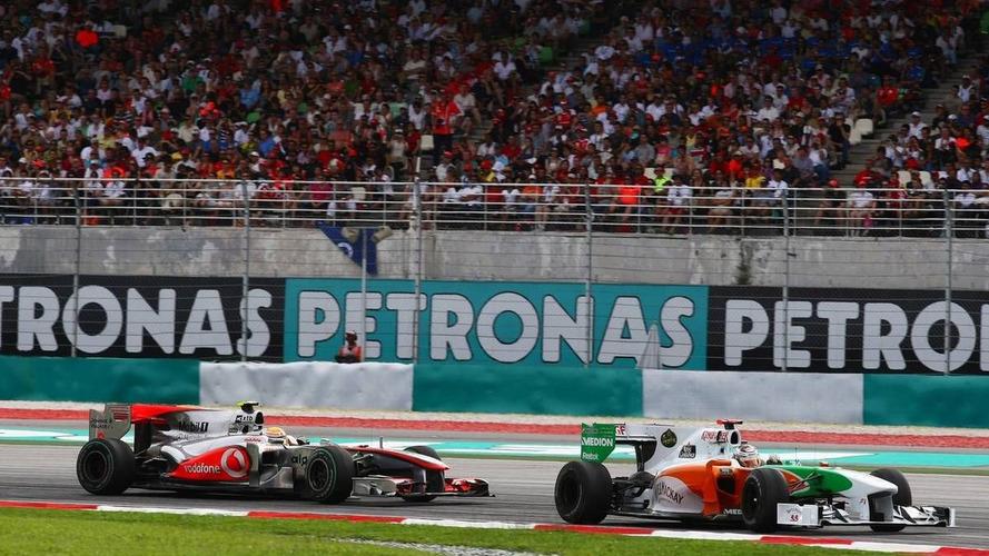 Press hails Hamilton, Alonso, after Sepang struggles