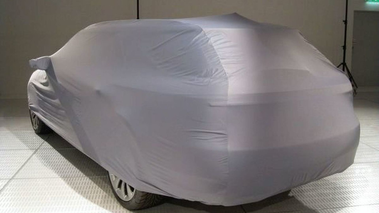 2010 Saab 9-5 with car cover