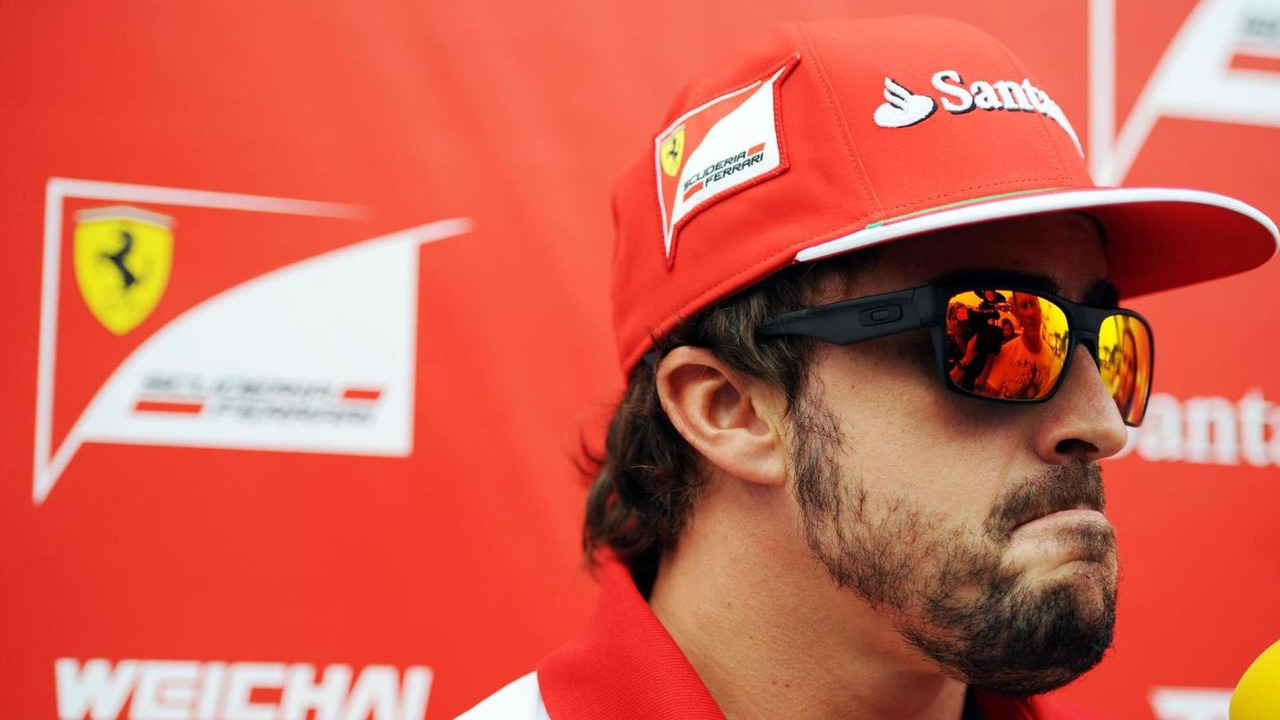 Fernando Alonso (ESP) with the media, 18.09.2014, Singapore Grand Prix, Singapore / XPB