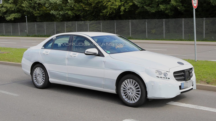 2014 Mercedes-Benz C-Class spied up close wearing white camo