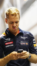 Sebastian Vettel on mobile phone 19.09.2013 Singapore Grand Prix