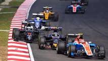 Esteban Ocon, Manor Racing MRT05 leads Carlos Sainz Jr., Scuderia Toro Rosso STR11 and Fernando Alonso, McLaren MP4-31