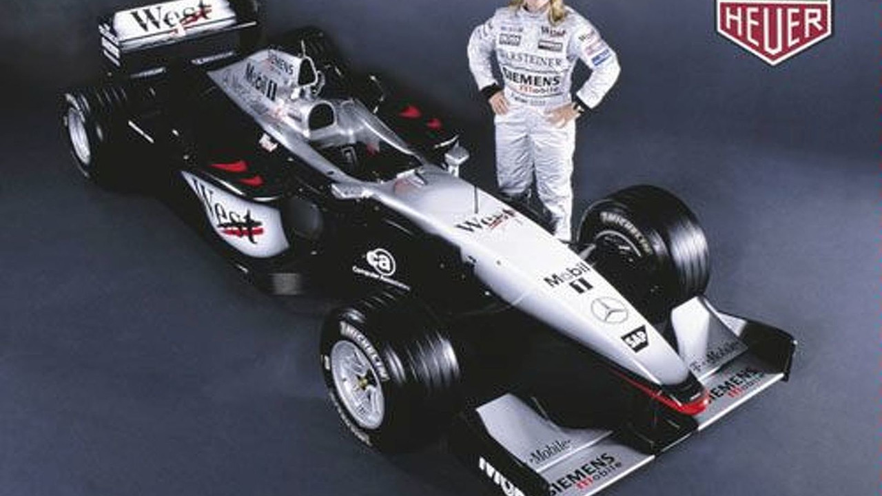 Sara Fischer withMcLaren Mercedes MP4-17