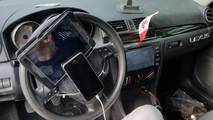 Smartphone and tablet on steering wheel